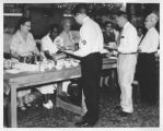 Civil Defense members are being served 'Disaster Meal' at Delgado Trades School